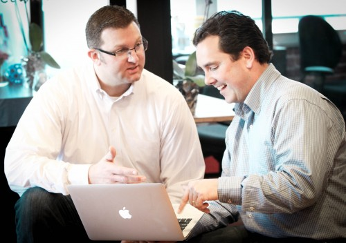 The FlexScore partners talking strategy. Jason is on the right.