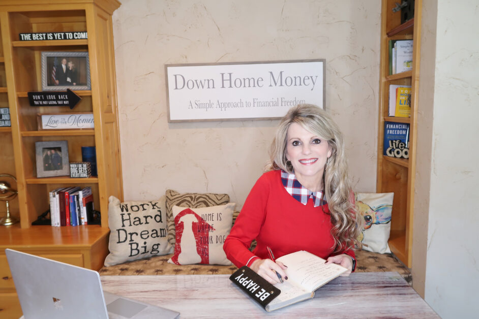 Photo of Myra Oliver with book, Down Home Money